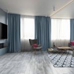 Просторная гостиная в голубых тонах в квартире ЖК по ул. Обуховская