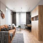 Вариант совмещения гостиной и рабочей зоны в небольшой квартире в ЖК Демеевский